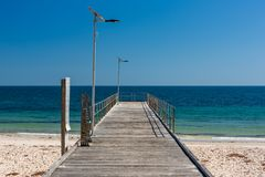 The iconic Normanville jetty with no people and blue skies on a bright sunny day on the Fleurieu Peninsula South Australia  on stock photo
