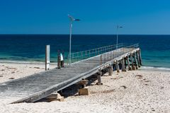 The iconic Normanville jetty with no people and blue skies on a bright sunny day on the Fleurieu Peninsula South Australia on 20th stock photography