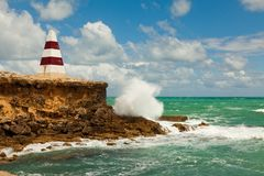 The iconic Obelisk during the day with rough seas at Robe South royalty free stock image