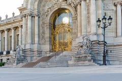 : Iconic Petit Palais Gate near famous Alexander III bridge Stock Photography