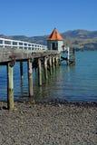 Iconic Pier Jetty in Akaroa, New Zealand royalty free stock photo