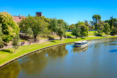 Iconic Pop-Eye boat with people. Adelaide, Australia - April 14, 2017: Iconic Pop-Eye boat with people on board traveling upstream Torrens river in Adelaide CBD royalty free stock photography