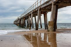 The iconic Port Noarlunga Jetty and its reflection in the water. Below locatedin South Australia on 23rd August 2018 royalty free stock images
