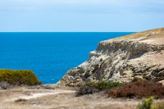 The iconic Port Willunga beach and surrounding cliffs on a clear sunny day in South Australia on 14th February 2019 stock images