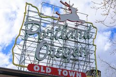 Iconic Portland, Oregon Old Town sign with an outline of Oregon and a stag. Portland, United States - Apr 10, 2018 : Iconic Portland, Oregon Old Town sign with Royalty Free Stock Photo