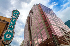 Iconic Portland Sign. With pink skyscraper rising next to it Stock Photos