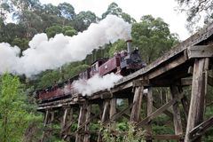 The iconic Pulling Billy Steam Train on the Trestle bridge in th. E Dandenong Ranges on 27th April 2012 royalty free stock photography