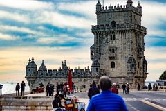 The iconic quarter façade of the Tower of Belém on the bank of the Tagus River. This tower was built  for defense purposes. Iconic quarter faade tower belm royalty free stock photo