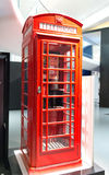 Iconic red British telephone booth on display. Iconic empty new red British public telephone booth on display in a museum in London, UK Stock Photo