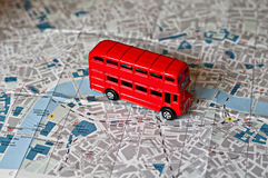 The iconic red bus miniature. On the map of London Stock Image