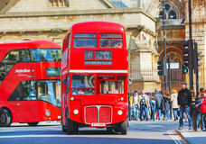 Iconic red double decker bus in London. LONDON - APRIL 12: Iconic red double decker bus on April 12, 2015 in London, UK. The London Bus is one of London's Royalty Free Stock Image