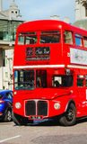 Iconic red double decker bus in London. LONDON - APRIL 12: Iconic red double decker bus on April 12, 2015 in London, UK. The London Bus is one of London's Stock Image