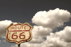 Iconic Route 66 sign. Framed by the blue cloudy sky Royalty Free Stock Photography