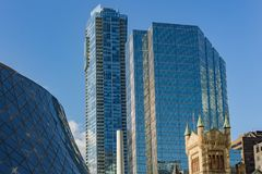 Royal Thompson Hall and St Andrews Church with modern bank skyscrapers stock images