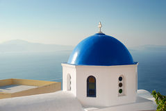 Iconic Santorini view of Caldera with blue dome of church Royalty Free Stock Images