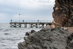 The iconic Second Valley cliff with the a selective blur of the. Jetty in the background. Taken on the Fleurieu Peninsula South Australia on 1st November 2018 stock photos
