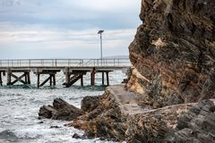 The iconic Second Valley cliff with the a selective blur of the. Jetty in the background. Taken on an overcast day on the Fleurieu Peninsula South Australia on stock photos