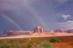 Iconic Southwest. Double rainbows shine above Monument Valley stock photos