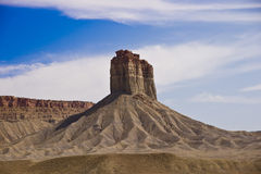 The Iconic Southwest. An iconic southwestern butte towers above the desrt landscape Royalty Free Stock Photo