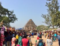 The iconic Sun Temple at Konark, Odisha. Visitors thronging the world heritage site at Sun Temple, Konark in the province of Odisha, India Stock Photos