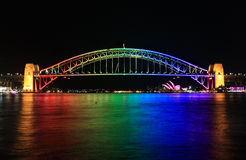 Iconic Sydney Harbour Bridge in rainbow colour during Vivid Sydn Stock Photo