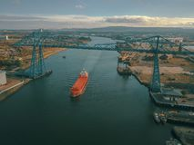 The iconic Teesside Transporter Bridge with a large ship passing under it. royalty free stock image