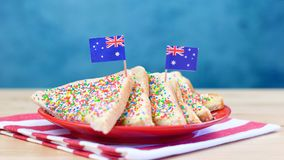 Iconic traditional Australian party food, Fairy Bread with flags. Iconic traditional Australian party food, Fairy Bread, on a red, white and blue background royalty free stock image