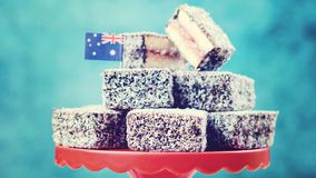 Iconic traditional Australian party food, Lamington cakes, vintage. Iconic traditional Australian party food, Lamington cake, on a red, white and blue stock images