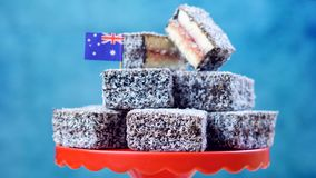 Iconic traditional Australian party food, Lamington. Cake, on a red, white and blue background royalty free stock photography