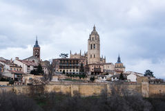 An iconic view to the center of Segovia, Cathedral and old medieval buildings over the hill, Segovia Royalty Free Stock Photo