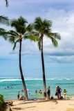 The iconic Waikiki Beach during the day with a crowd of people a. Ppreciating the view in Honolulu Hawaii on the 4th October 2018 royalty free stock photos