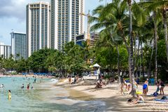 The iconic Waikiki Beach during the day with a crowd of people a. Ppreciating the view in Honolulu Hawaii on the 4th October 2018 stock photography