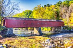 West Cornwall covered bridge autumn. The iconic west cornwall covered bridge spanning the Houstonic River in Connecticut during the new england autumn royalty free stock images
