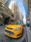 An iconic yellow cab in downtown Manhattan Royalty Free Stock Photo