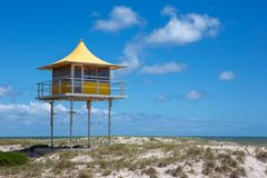 The iconic yellow lifeguard tower at Semaphore with blue skies a. Nd fluffy clouds at Semaphore South Australia on 7th November 2018 royalty free stock photo