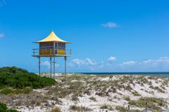 The iconic yellow lifeguard tower at Semaphore with blue skies a. Nd fluffy clouds at Semaphore South Australia on 7th November 2018 royalty free stock photos