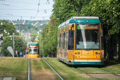 The iconic yellow trams of Norrkoping, Sweden. Norrkoping, Sweden - June 19, 2016: The iconic yellow trams of Norrkoping. Norrkoping is a historic industrial Royalty Free Stock Image