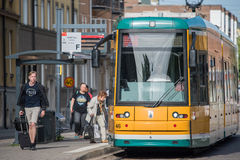 The iconic yellow trams of Norrkoping, Sweden. Norrkoping, Sweden - June 19, 2016: The iconic yellow trams of Norrkoping. Norrkoping is a historic industrial Stock Photos