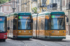 The iconic yellow trams of Norrkoping, Sweden. Norrkoping, Sweden - June 19, 2016: The iconic yellow trams of Norrkoping. Norrkoping is a historic industrial Royalty Free Stock Images