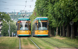 The iconic yellow trams of Norrkoping, Sweden. Norrkoping, Sweden - June 19, 2016: The iconic yellow trams of Norrkoping. Norrkoping is a historic industrial Stock Photo