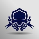 Icono azul de la bandera del escudo en el fondo gris Imagen de archivo libre de regalías