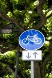 Icono azul de la bici Imagenes de archivo