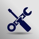Icono azul de la herramienta del trabajo en el fondo gris Imagen de archivo libre de regalías