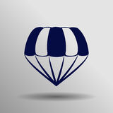 Icono azul del paracaídas en el fondo gris Foto de archivo libre de regalías