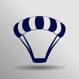 Icono azul del paracaídas en el fondo gris Fotografía de archivo libre de regalías