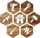 Icono de bricolaje en un fondo de madera imagen de archivo libre de regalías