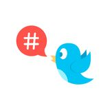 Icono de Hashtag en burbuja roja del discurso con el pájaro azul Imágenes de archivo libres de regalías