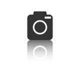 Icono de la cámara con efecto de la reflexión sobre el fondo blanco Imágenes de archivo libres de regalías