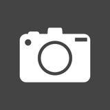 Icono de la cámara en fondo negro Imagenes de archivo