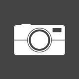 Icono de la cámara en fondo negro Imagen de archivo